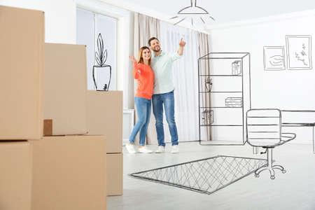 Moving to new house. Happy couple imagining living room arrangement. Illustrated interior design Archivio Fotografico