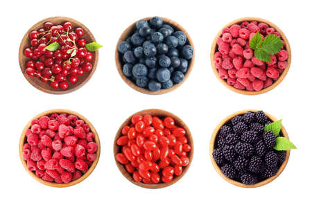 Set of bowls with different fresh berries on white background, top view