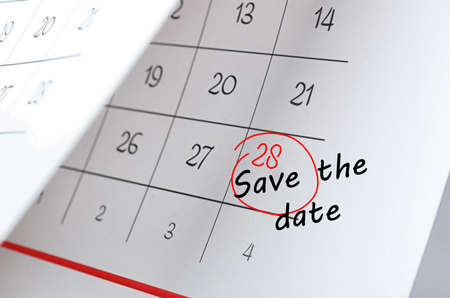 Paper calendar with phrase SAVE THE DATE, closeup Standard-Bild