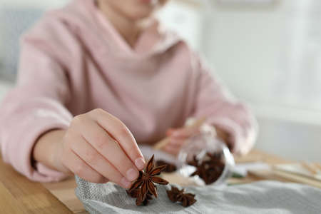 Little girl working with natural materials at table indoors, closeup. Creative hobby 版權商用圖片