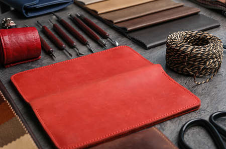 Leather samples and craftsman tools on grey stone background 版權商用圖片