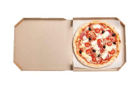 Delicious pizza Diablo in cardboard box isolated on white, top view Foto de archivo