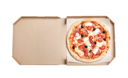 Delicious pizza Diablo in cardboard box isolated on white, top view Imagens