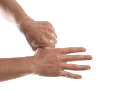 Man washing hands with soap on white background, closeup