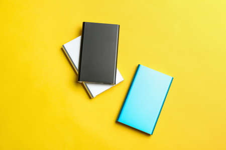Modern external portable chargers on yellow background