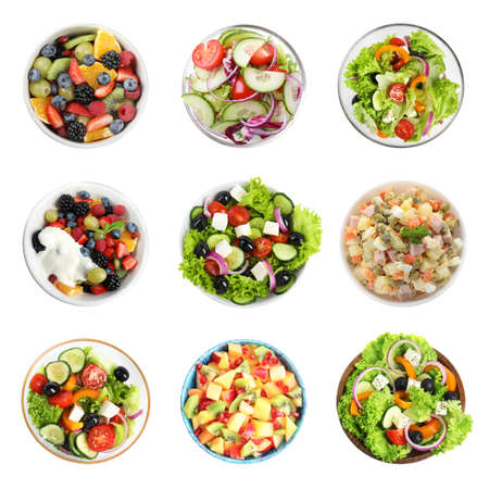 Set with different salads on white background, top view