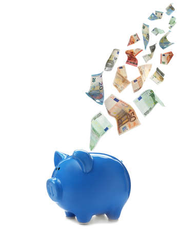 Euro banknotes falling into blue piggy bank on white background
