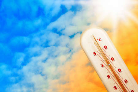 Weather thermometer with high temperature and color sky on background, space for text