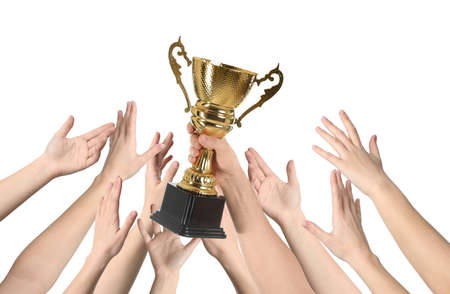 People with golden trophy cup on white background, closeup
