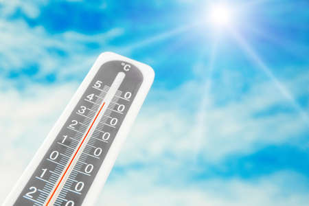 Weather thermometer with high temperature and beautiful sky on background, space for text Stock fotó