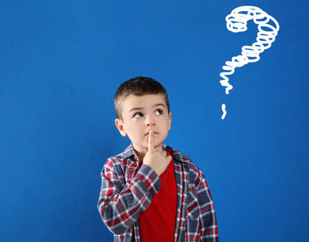 Emotional boy with drawing of question mark on blue background