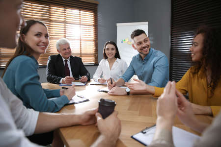 Group of people discussing questions at business seminar Stock Photo