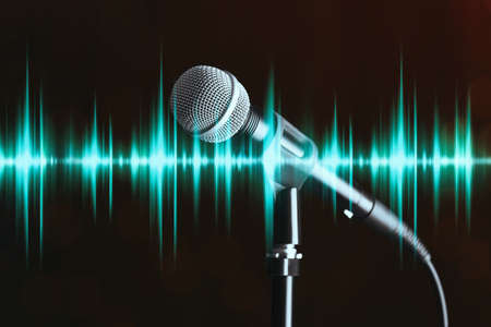 Microphone and radio wave on dark background Banque d'images