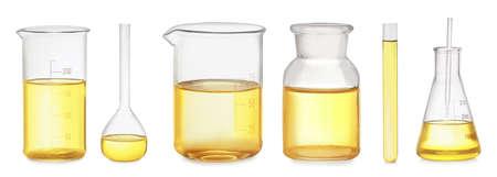 Set of laboratory glassware with yellow liquid on white background. Banner design Stockfoto