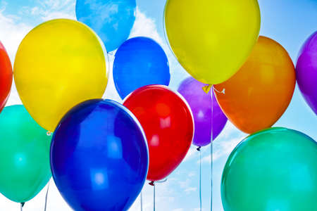 Many colorful balloons outdoors on sunny day, closeup