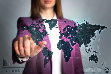 Travel agency services. Woman touching world map on virtual screen