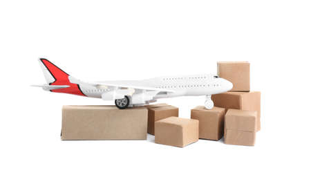 Airplane model and carton boxes on white background. Courier service