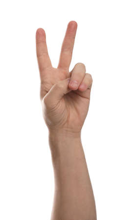 Man showing peace sign against white background, closeup of hand