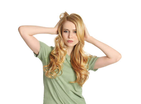 Portrait of beautiful young woman with dyed long hair on white background