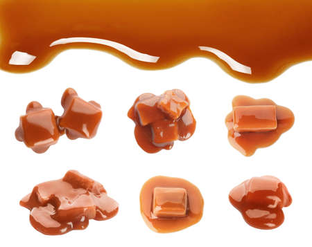 Set with caramel candies and tasty sauce on white background