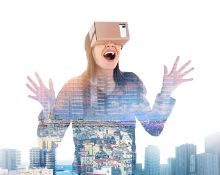 Double exposure of woman using virtual reality headset and cityscape. Modern exposure