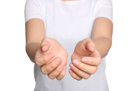 Woman against white background, closeup on hands