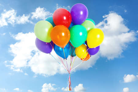 Many colorful balloons outdoors on sunny day