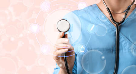 Doctor with stethoscope on pink background, closeup. Medical service Banque d'images