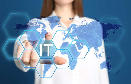Information technology concept. Woman pointing at world map on blue background, closeup
