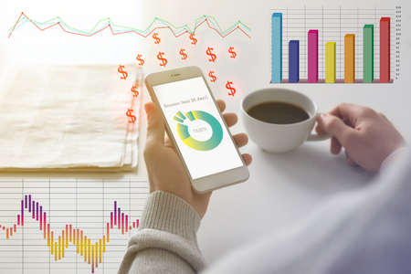 People making money. Closeup of businessman using smartphone indoors surrounded by digital charts and dollar signs