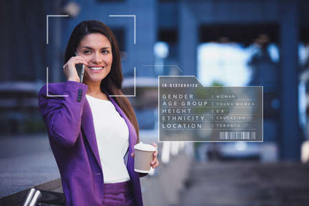People search by facial recognition. Woman outdoors with scanner frame on face and her private information Stock Photo