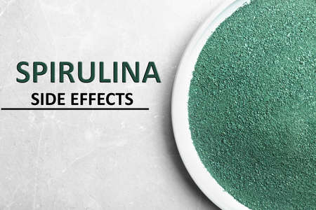 Plate of spirulina powder on light background, top view. Side effects