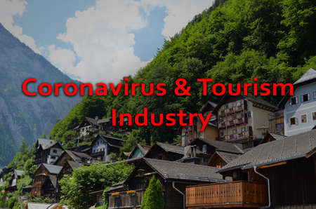 Trips cancellation during coronavirus quarantine. Town with beautiful buildings near mountains Stock Photo