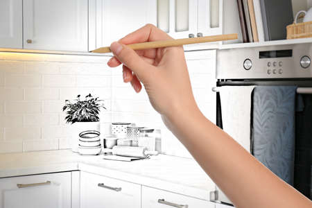 Woman drawing kitchen interior design. Combination of photo and sketch