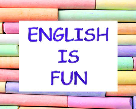 Many pieces of color chalk as background, top view. English is fun Фото со стока