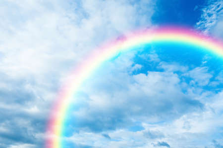 Picturesque view of beautiful rainbow and blue sky on sunny day