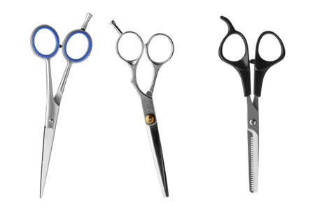 Set of different professional hairdresser scissors on white background