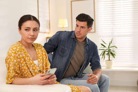 Couple quarreling due to jealousy in relationship at home