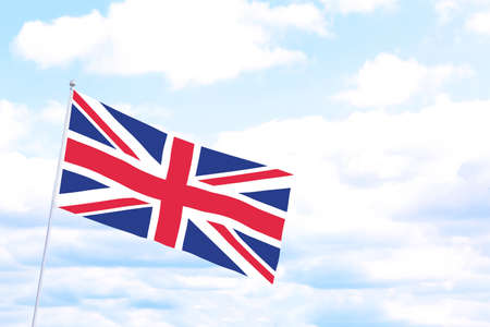 Flag of Great Britain outdoors on cloudy day, space for text. Learning English