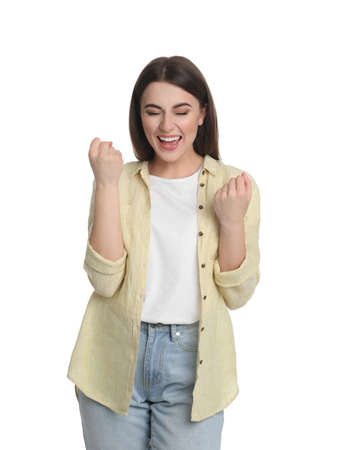 Portrait of excited young woman on white background Banque d'images