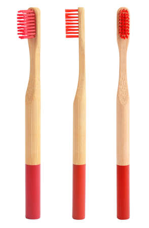 Set of bamboo toothbrushes with red bristles on white background Archivio Fotografico