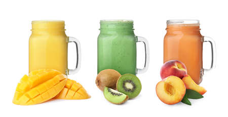Different delicious smoothies in mason jars on white background. Banner design Stock Photo