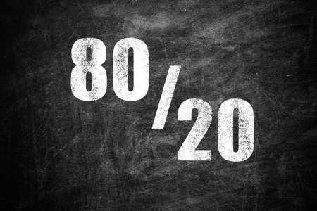 Pareto principle concept. 80/20 rule representation on chalkboard