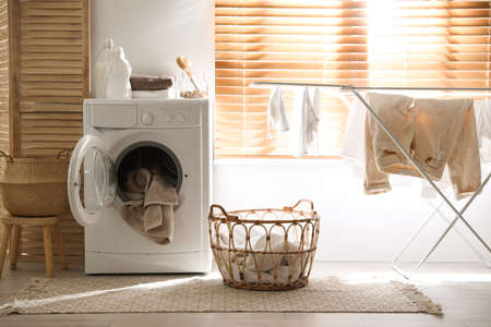 Stylish room interior with washing machine. Design idea