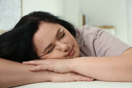 Lazy overweight woman sleeping at home, closeup