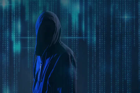 Hacker and digital binary code on dark background. Cyber crime concept