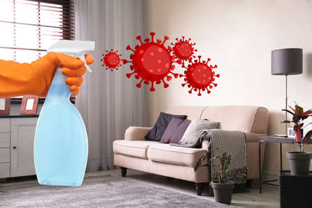 Keep your home virus-free. Woman cleaning room with disinfecting solution Standard-Bild