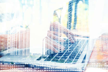 Woman with laptop and modern buildings, closeup. Double exposure