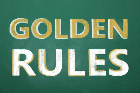 Green chalkboard with phrase GOLDEN RULES, closeup