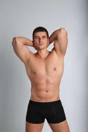 Man with muscular body on light background Zdjęcie Seryjne